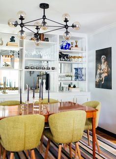 Very chic dinning room I like the glass shelves against the wall