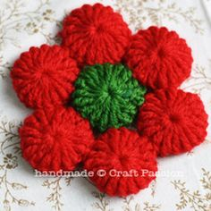 Holiday Crochet Coasters - Instead of buying coasters, opt for DIY coasters. These ones are a great Christmas craft to work on during July, too!
