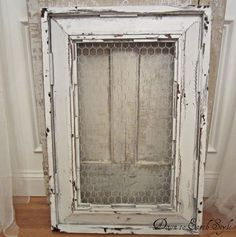 Down to Earth Style: A Salvaged Frame--cute idea for the garden, looks like part of an old screen door.