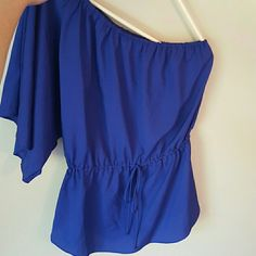Mossimo purplish blue one shoulder shirt This is a purplish blue Mossimo one shoulder shirt in great condition!! The capris in the last picture are also available in my closet! Feel free to ask questions or comment!! Mossimo Tops