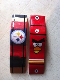 Pinewood Derby cars before wheels.  I drew the outline of the bird face and my 6 yo painted it in himself.  The Stealers logo is just a print out.