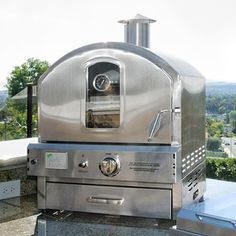 Pacific Living has created a stainless steel outdoor gas pizza oven with style and ease. This stainless steel outdoor gas pizza oven takes grilling and barbecuing to another level of excitement. Gas Pizza Oven, Pizza Oven Outdoor, Pizza Ovens, Built In Gas Ovens, Outdoor Gas Grills, Outdoor Kitchen Countertops, Countertop Oven, Outdoor Kitchens, Kitchen Island