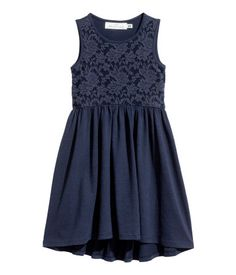 Dark blue. Sleeveless dress in soft slub cotton jersey. Bodice with lace-covered front section. Seam at waist and gathered skirt. Slightly longer at back.