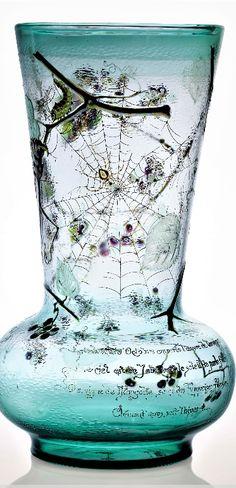 ÉMILE GALLÉ (1846-1904) 'La Vigne de Mongolie' a Verriere Parlante Vase, 1889 acid-etched, engraved and enameled with fruiting stems, daddy-long legs, caterpillar, bee, a spider in a web with flies, against a martelé ground 16 ¼ in. (41.2 cm.) high engraved Emile Gallé de Nancy 1889 Exposit Paris, Cross of Lorraine, La brume d'Octobre emporte l'oeuvre de l'araignée Le ciel est de jade vert, le soleil de perle fine La vigne de Mongolie sème des Turquoises frileuses Clément nous soit l'hiver Pottery Vase, Pottery Clay, Slab Pottery, Thrown Pottery, Pottery Studio, Bijoux Art Nouveau, Sandblasted Glass, Glass Ceramic, Ceramic Bowls