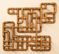 Brooklyn-based artist/designer TJ Volonis makes the most amazing sculptures and furniture out of copper tubing. The patterns and dimension created are complex mazes of lines and curves that join together to make the most intricate pieces.