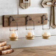 3 Glass Bottles on Hooks and Wood Wall Hanger is a rustic set of wall hooks with wire bottles. Visit Antique Farmhouse for more farmhouse decor. Metal Plant Hangers, Wall Plant Hanger, 3d Wall Decor, Metal Wall Decor, Wall Wood, Antique Farmhouse, Farmhouse Decor, Farmhouse Ideas, Country Farmhouse