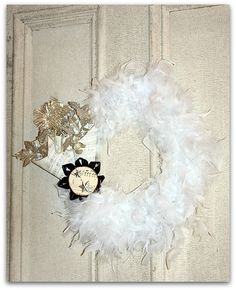Fluffy Feather Wreath made from feather boas. Love the paper decoration.
