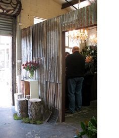 Corrugated metal feature wall, rustic elements (mud room?)