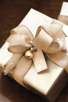 Burlap ribbon and a kraft tag - this simple idea might be monochromatic, but it's very rustic and pretty!