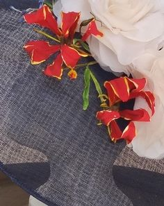 Cold Porcelain Flame Lily for a home made sinamay hat.