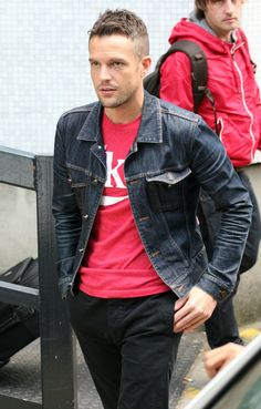 Brandon Flowers wearing a coke shirt.  Supporting the family income already... lol