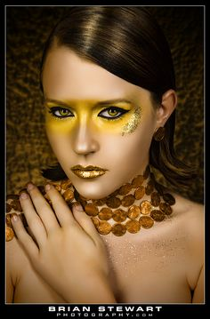 Pamella - Model Hallie - This is just inspiration, I am thinking a very bold face mask but not a full mask on Hallie.      Makeup - Metallic - Gold - Yellow Around Eye's w/black thick eyeliner - Gold Metallic Lips