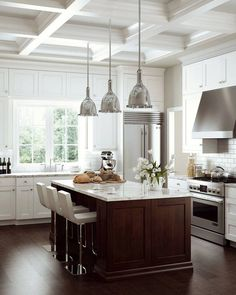 Wow what a kitchen! This kitchen used beautiful dark wood floors and island cabinets with pristine white counter tops and wall cabinets surrounding. This unique blend of materials and colors leaves this kitchen with an artistic modern style blend, but still maintains a sense of home and warmth. Truly an amazing kitchen and you could have one like this too. Check out LaFata.com for all of our products and a free cabinet estimate, or give us a call at (586) 247-1140.