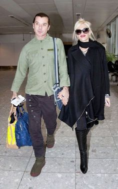 Heading home for the holiday, Gwen Stefani and Gavin Rossdale boarded a flight out of London's Heathrow Airport this morning (November 23).