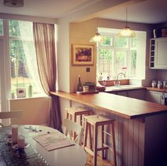 My kitchen. Country feel kitchen/dining room with breakfast bar, with cream cupboards and oak worktops. Garden Trading pendants add warm lightning.