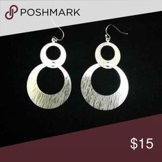 "Silver Double hoop Earrings (SALE) Silver over rhodium textured earrings!  Approximately 2"" long bottom circle is 1 1/2"" X 1 1/2"" Lia Sophia Jewelry Earrings"