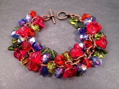 Flower Charm Bracelet Love in Bloom Colorful and by justCHARMING https://www.etsy.com/listing/34970493/flower-charm-bracelet-love-in-bloom