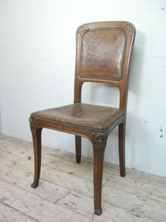 Hard to find art nouveau chair with leaf and flower carvings to frame and original embossed leather upholstery{br}£300 (Click to enlarge)