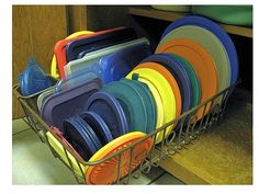 Very clever #TuesdayTip from Connie: 'I use a dish rack to hold my Tupperware lids & place it in the cupboard.'