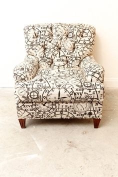"Time Will Tell Chairhis a custom made club chair covered in an antique looking clock print. This chair is very comfortable and exudes quiet elegance. It reminds me a bit of Sherlock Holmes movies and The Clock episodes in Hercule Poirot.  I think I would love to have this piece. It is definitely fun.    40"" D  33"" W  35"" T"