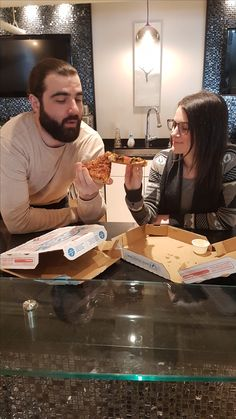 A couple TWers enjoying #NationalPizzaDay .. with an entire pie each!
