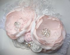 Baby Girl Flower headband  So sweet and feminine! Pink and Taupe handmade flower headband with hand rolled rosettes and flowers that is simply stunning. Features lace, tulle, pleated tulle with pearl edging, Ostrich Feathers and beautiful pink Dupioni silk bow. High Quality gold set Rhinestones and gorgeous Pearl clusters to coordinate with colors. Flowers are attached to a quality Taupe lace headband.  Beautiful detailing and fabulous for any occasion, expect tons of compliments…