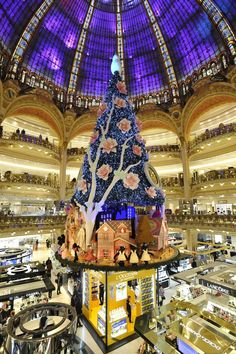 The Christmas tree at Galeries Lafayette, done with Swatch. [Photo by Dominique Maître]