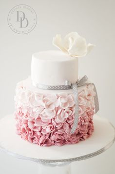 An ombre pink petal ruffle cake for a birthday celebration.