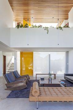 Linhares Dias House by DOMO Arquitetos.  Love the rockers of reclaimed wood.