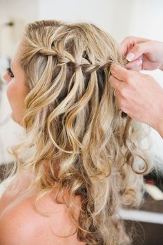 Loose curls with a simple but elegant braid detail makes the perfect beach wedding hairstyle. Read more at : http://theweddingly.com/