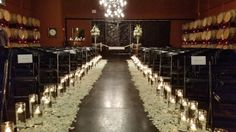 Winery Wedding, wine cave wedding, Aisle laid with white rose petals, glass cylinder vases and candles light the way for the bride and groom. Petal Town Flowers #winecountryweddingflowers #Sonomacountyweddingflowers #petalumaflorist