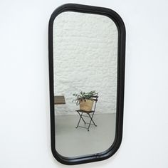 Miroir mural ovale en métal noir OPHELIA