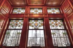 Art glass at Glensheen showing the tudor rose design that is a consistent theme through out the 2nd floor main hall
