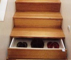 Shoe storage under the stairs!  Pefect for a backdoor staircase or mudroom.