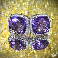 Amethyst and Diamond Earrings are the ultimate in glamour. Two incredible cushion cut amethysts are surrounded by 56 sparkling Round Brilliant Diamond Melee