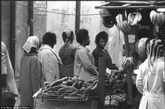 These west African women are shopping for fruit and vegetables in a Brixton market stall