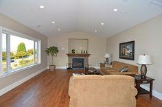 #CrownMolding #CoffeeTable #Window #StoneFireplace #HardwoodFloor #CeilingVent #Couch #EndTable #Livingroom