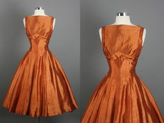 "What a gorgeous copper taffeta!  A lovely 1950s dress with a unique ""v"" shape at the empire waist."