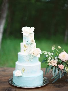 blue wedding cakes - photo by Courtney Leigh Photography…