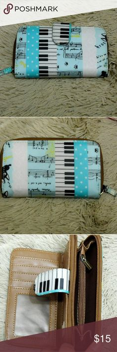 Adorable Luna Hana keyboard music themed wallet Super super cute. Baby blue and white with a brown interior. Man made materials. Plenty of slots for credit cards, a window slot for ID, cash slots and a seperate compartment for cash and a zippered coin pouch.  6.5 inches long and 3.75 inches tall. EUC Una Hana Bags Wallets