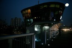 """Cafe Happiness Plus on Hannam Bridge - On many of the bridges that cross the Han River, there are cafes where visitors can enjoy spectacular views of the Seoul skyline.  """"Cafe Happiness Plus"""" is located at the end of the Hannam Bride and is the perfect place to watch the sun set on Korea's capital city.  To get there:  Subway - Sinsa Stn. (Line 3, Exit 6) and walk for 15 minutes."""