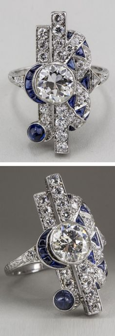 Tiffany & Co. - An Art Deco platinum, diamond and sapphire ring, circa 1935. Set to the centre with a round diamond, approximately 1.60 carats, accented with round diamonds and calibré sapphires.