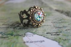 Blue Glass Opal on Antiqued Ring. Want.