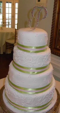 I don't like the P on top! But the rest is beautiful! hmmm... white on white? Ivory on white? Green ribbon