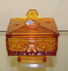 "VINTAGE Fenton Art Glass Amber HONEYCOMB & BEE LIDDED HONEY DISH.Was designed by a Illinois Beekeeper made by Fenton for him, sold in the January 1965 Fenton catalog 5""H (to finial x 4.5""square (3""H without lid). Beekeeping, Amber Glass, Kitchen Stuff, Honeycomb, Vintage Kitchen, Illinois, Glass Art, Pots, Catalog"
