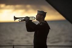 Master-at-Arms plays Taps during a burial at sea aboard USS Carl Vinson. Uss Intrepid, Navy Rings, Go Navy, Us Coast Guard, Us Marine Corps, Military Photos, United States Navy, Aircraft Carrier, Battleship