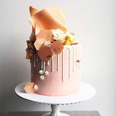 Seeing such a pretty pink wedding cake is always a lovely sight. The gold-leaf style geometric shapes are a modern detail which really stands out on the design and the white drips are another beautiful addition too. There is not one thing we would change about this wedding cake by Don't Tell Charles.