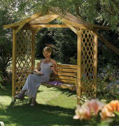 The Poseidon Wooden Garden Swing Seat Arbour is a relaxing place to sit with friends. Visit Buy Sheds Direct for our superb range of arbours and for more. Garden Arbour Seat, Arbor Swing, Garden Benches, Garden Seating, Wooden Garden Swing, Wooden Swings, Garden Buildings, Garden Structures, Outdoor Structures