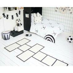 Beautiful Scandi Monochrome Room with KAOS Paradishopp Hopscotch Rug