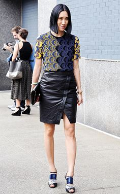Eva Chen wearing a black leather envelope skirt and a Derek Lam shirt.